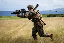 A U.S. Marine with Fox Company, 2nd Battalion, 3rd Marine Regiment, III Marine Expeditionary Force, charges toward a target during a squad supported attack at the Kaneohe Bay Range Training Facility, Marine Corps Base Hawaii, March 5, 2019.