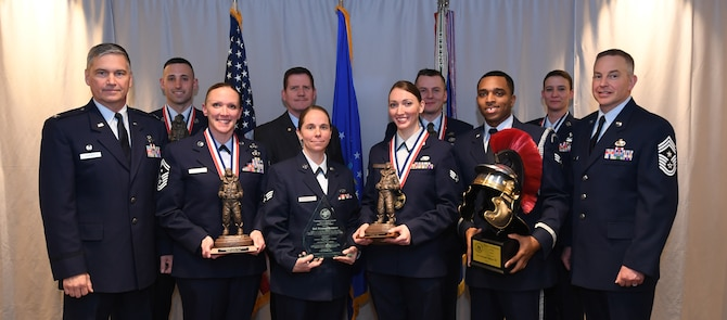 911th Airlift Wing award winners stand to be recognized with Col. Douglas N. Strawbridge, commander of the 911th AW, and Chief Master Sgt. Christopher D. Neitzel, command chief of the 911th AW, during the 911th AW Annual Award Ceremony at the Pittsburgh International Airport Air Reserve Station Pennsylvania, March 2, 2019. The 2018 Awards Ceremony recognizes Airmen that went above and beyond in their service for the year 2018. (U.S. Air Force Photo by Senior Airman Grace Thomson)
