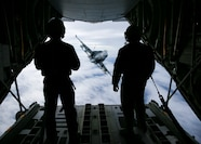 U.S. Marine corporals Reid Geyer and Michael Womack, crewmasters with Marine Aerial Refueler Transport Squadron 352, Marine Aircraft Group 11, 3rd Marine Aircraft Wing, prepare to refuel an F/A-18 Hornet with Marine Fighter Attack Squadron 323, MAG-11, carrying ten AIM-120 and two AIM-9X Air-to-Air missiles, over the W-291 training area in southern California, March 6.