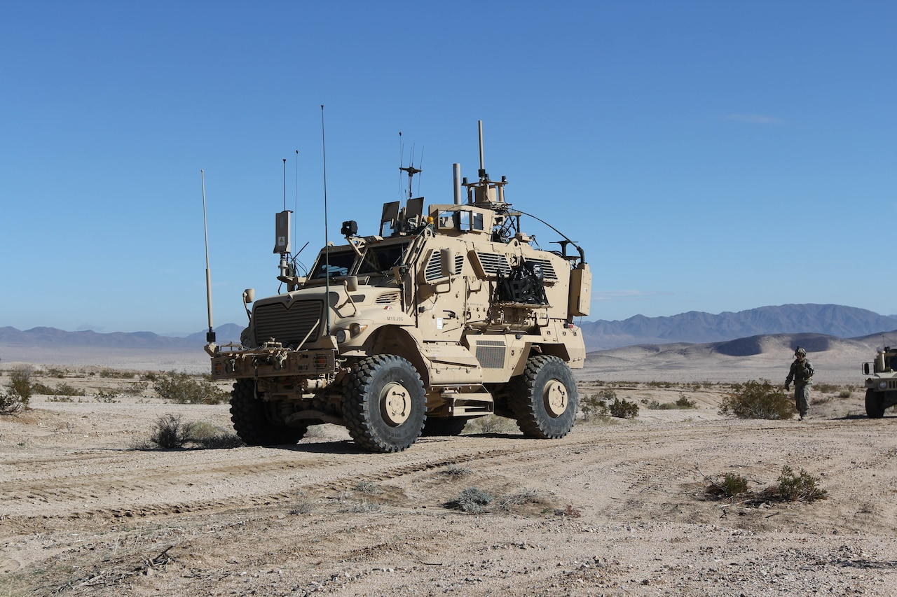 Tactical vehicle moves through desert