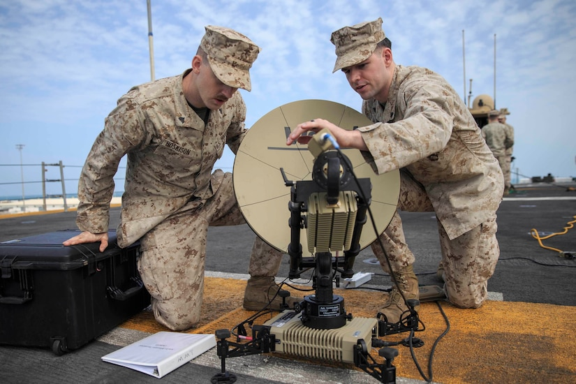 Marines look at satellite dish