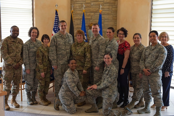 U.S. Air Force personnel pose for a group photo with U.S. Air Force Lt. Gen. Dorothy Hogg, Air Force surgeon general, at Fireside lounge on Spangdahlem Air Base, Germany, March 6, 2019. Hogg and U.S. Air Force Chief Master Sgt. G. Steve Cum, Medical Enlisted Force and Enlisted Corps chief, spent time with Airmen answering their questions. (U.S. Air Force photo by Airman 1st Class Branden Rae)