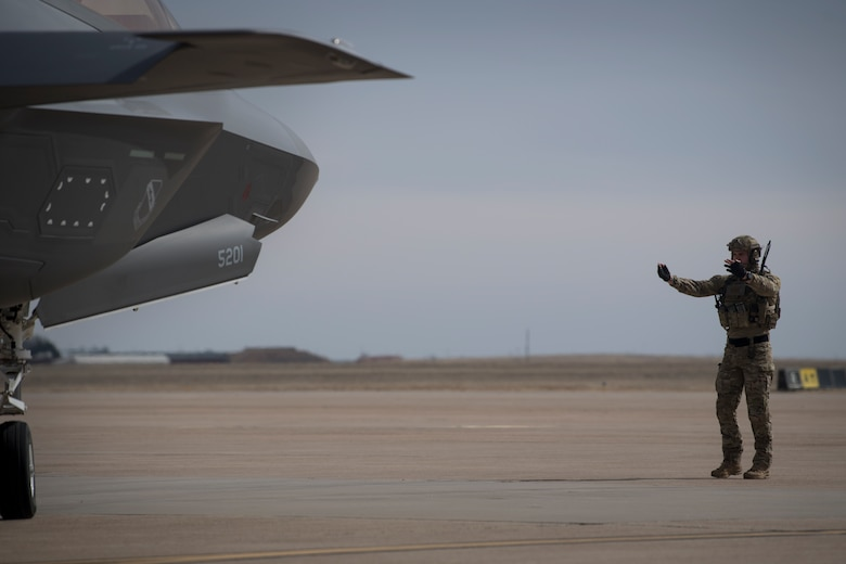 Airmen from the 388th Fighter Wing at Hill Air Force Base, Utah, and Air Commandos from the 26th Special Tactics Squadron and the 27th Special Operation Logistics Readiness Squadron conduct a forward area refueling point from an MC-130J Commando II to an F-35A Lightning II at Cannon AFB, N.M., Feb. 27, 2018.