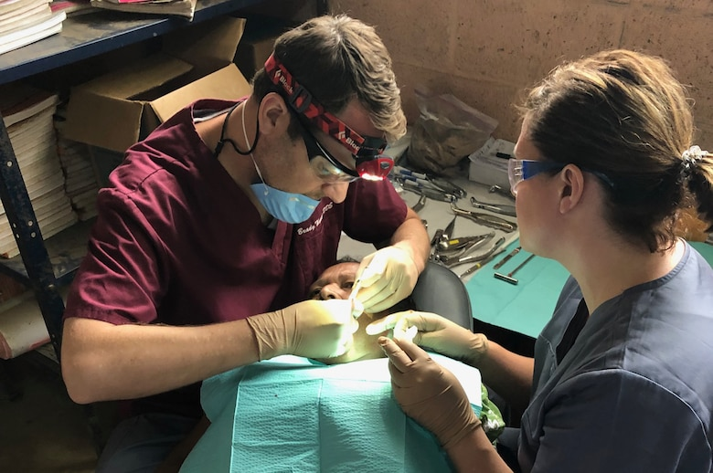 Lt. Col. Brady Thomson, a reservist in the 419th Medical Squadron, performs dental work on a Guatemalan resident during a recent humanitarian mission to Chiquimula.