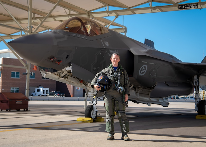 Maj. Valerie Wetzbarger, 62nd Fighter Squadron F-35A Lightning II instructor pilot, stands in front an F-35 after landing, Feb. 8, 2019 at Luke Air Force Base, Ariz.