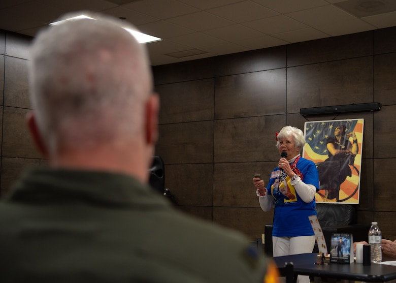 "Col. Michael Richardson, 56th Fighter Wing vice commander, listens to Caroline Kilgore, a local ""Rosie"" during a Women's History Month kick-off breakfast, March 8, 2019 at Luke Air Force Base, Ariz."