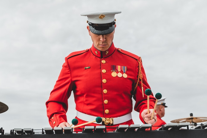 "A U.S. Marine with ""The Commandant's Own"", The United States Marine Drum & Bugle Corps, Battle Colors Detachment, Marine Barracks Washington, D.C., performs during the Battle Colors ceremony at Marine Corps Air Ground Combat Center, Twentynine Palms, Calif., March 11, 2019. The ceremony is held to honor Marine Corps traditions through the Drum Corps, the Silent Drill Platoon and the Battle Colors Detachment. (U.S. Marine Corps photo by Lance Cpl. Rachel K. Young-Porter)"