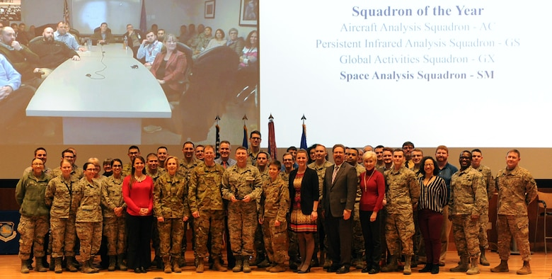 """Lt. Gen. VeraLinn """"Dash"""" Jamieson, Deputy Chief of Staff for Intelligence, Surveillance, and Reconnaissance and Cyber Effects, and Col. Parker Wright, National Air and Space Intelligence Center commander, recognize the Space Analysis Squadron as the NASIC squadron of the year, Feb. 27, 2019. Jamieson recognized the winners and nominees at NASICs annual award ceremony, during her visit to Wright-Patterson Air Force Base. (U.S. Air Force photo by Senior Airman Samuel Earick)"""