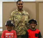 Georgia National Guard Sgt. Dominique Bailey, representing the Marietta-based 93rd Financial Management Support Unit, with two of her children. Bailey is recognized as an exemplary Soldier and mother during Women's History Month.