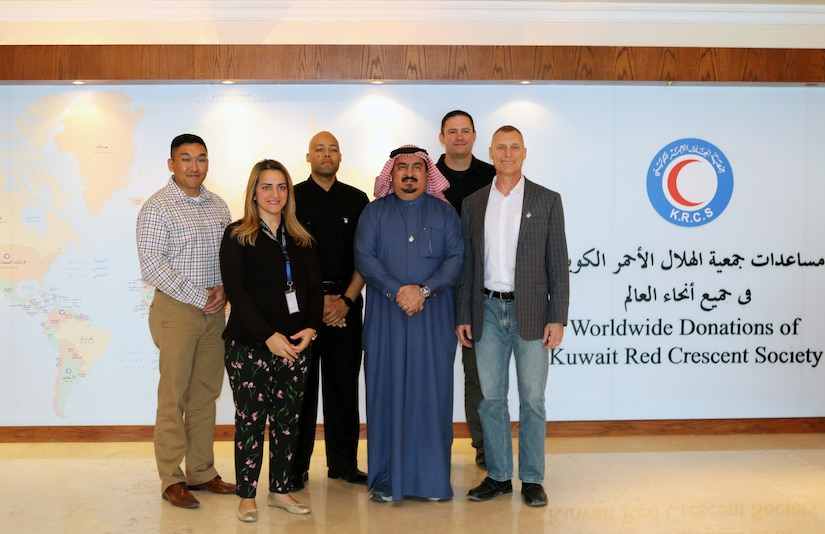 From left: Capt. Pil Jeon, Iman Haidar, Capt. Jermareo McDaniel, Yousef Al Merag, Staff Sgt. John Lee and Lt. Col. Charles Moore gather for a group photo after their meeting at the Kuwait Red Crescent Society headquarters and operations center in Kuwait City, on Feb. 18, 2019. The meeting between U.S. Army Civil Affairs personnel and the Kuwait Red Crescent Society is an effort to build interoperability and coordination between civilian and military organizations.