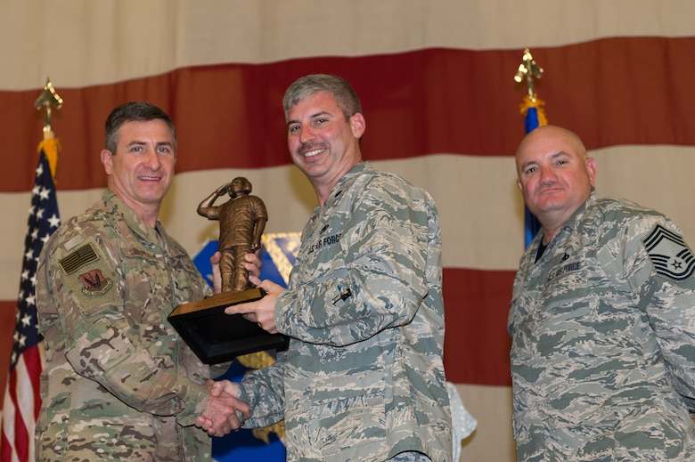 Lt. Col. Thane Sisson, 23d Maintenance Squadron (MXS), accepts the Lt. Gen. Leo Marquez Award on behalf of Tech. Sgt. Alan Stephenson, 23d MXS, March 8, 2019, at Moody Air Force Base, Ga. Stephenson won this award for the NCO in Aircraft Maintenance category. Maintenance Professional of the Year (MPOY) is a long-running tradition in the maintenance career field. MPOY is a ceremony that highlights that year's top performing Airmen. (U.S. Air Force photo by Airman 1st Class Hayden Legg)