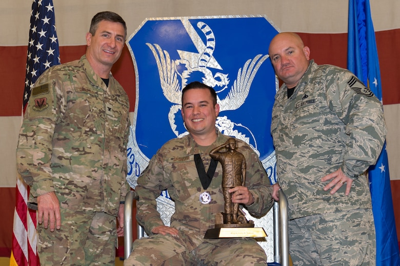 Master Sgt. Anthony Spencer, 23d Aircraft Maintenance Squadron, wins the Lt. Gen. Leo Marquez Award, March 8, 2019, at Moody Air Force Base, Ga. Spencer won this award for the Senior NCO in Munitions and Missile category. Maintenance Professional of the Year (MPOY) is a long-running tradition in the maintenance career field. MPOY is a ceremony that highlights that year's top performing Airmen. (U.S. Air Force photo by Airman 1st Class Hayden Legg)