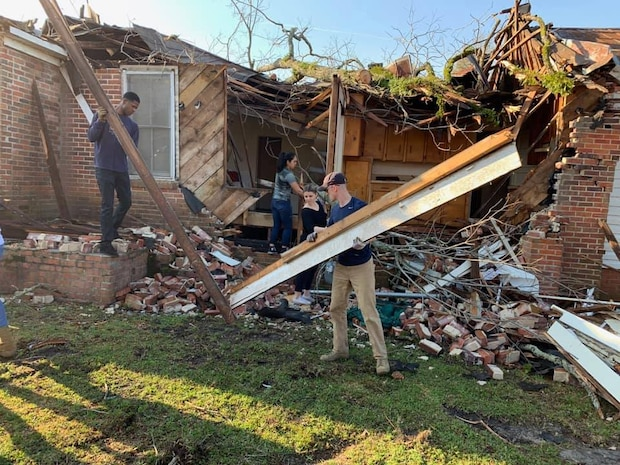 Dozens of Marines aboard Marine Corps Logistics Base Albany stepped up to lend a helping hand to the residents in Cairo, Ga, Mar. 12.
