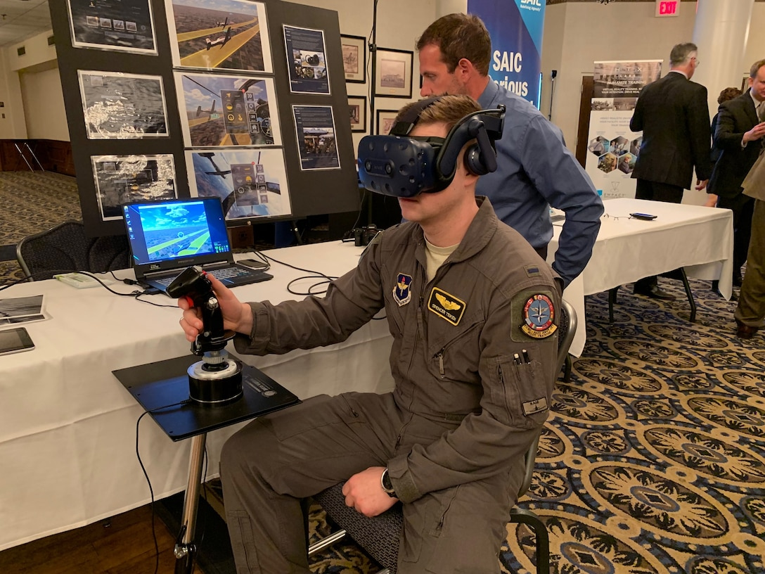 First Lt. Spencer Teiken from the 80th Operational Support Squadron at Sheppard Air Force Base, Texas, works through a virtual simulation problem during the Pilot Training Next Technology Expo at Joint Base San Antonio-Randolph, Texas, March 12, 2019. Technology currently being used at PTN was on display at the expo and subject matter experts and technology vendors were available to talk with attendees. (U.S. Air Force photo by Dan Hawkins)