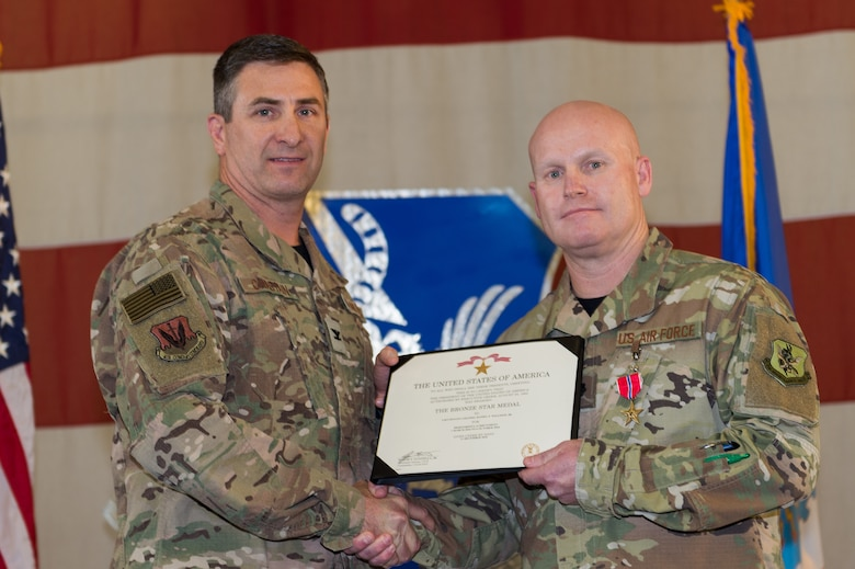 Lt. Col. Daniel Willison, 23d Maintenance Group, receives the Bronze Star, March 8, 2019, at Moody Air Force Base, Ga. Maintenance Professional of the Year (MPOY) is a long-running tradition in the maintenance career field. MPOY is a ceremony that highlights that year's top performing Airmen. (U.S. Air Force photo by Airman 1st Class Hayden Legg)