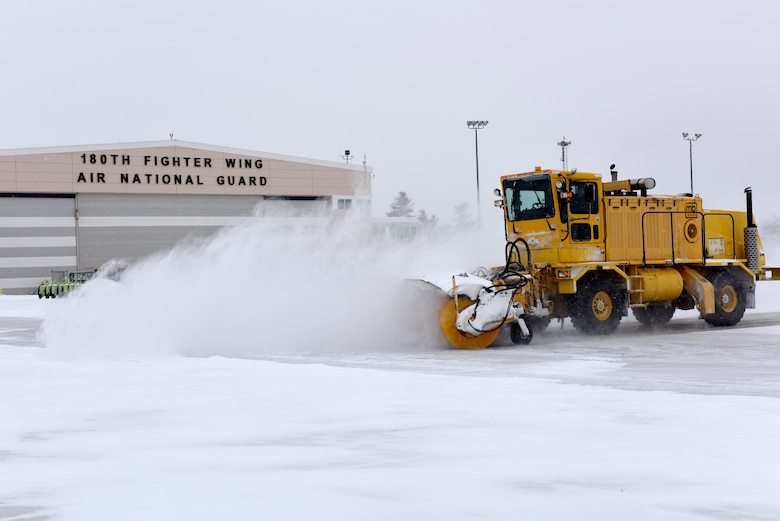 Heavy equipment removes snow and ice from the roads at the 180th Fighter Wing, Ohio Air National Guard during a polar vortex Jan. 28, 2019. Snow removal is a critical aspect of ensuring the 180FW can continue its mission, even in the worst weather conditions. (U.S. Air National Guard photo by Staff Sgt. Shane Hughes)