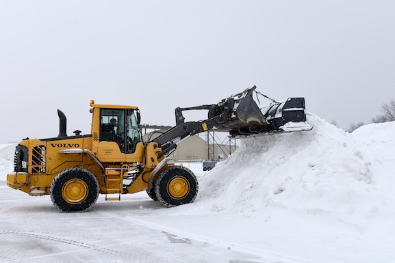 Heavy equipment removes snow and ice from the roads at the 180th Fighter Wing, Ohio Air National Guard during a polar vortex Jan. 28, 2019. Snow removal is a critical aspect of ensuring the 180FW homeland defense mission is always ready to respond to the nation's call. (U.S. Air National Guard photo by Staff Sgt. Shane Hughes)