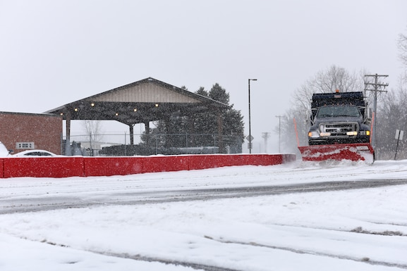 A plow removes snow and ice from the roads at the 180th Fighter Wing, Ohio Air National Guard during a polar vortex Jan. 28, 2019. Snow removal is a critical aspect of ensuring base personnel remain safe. (U.S. Air National Guard photo by Staff Sgt. Shane Hughes)