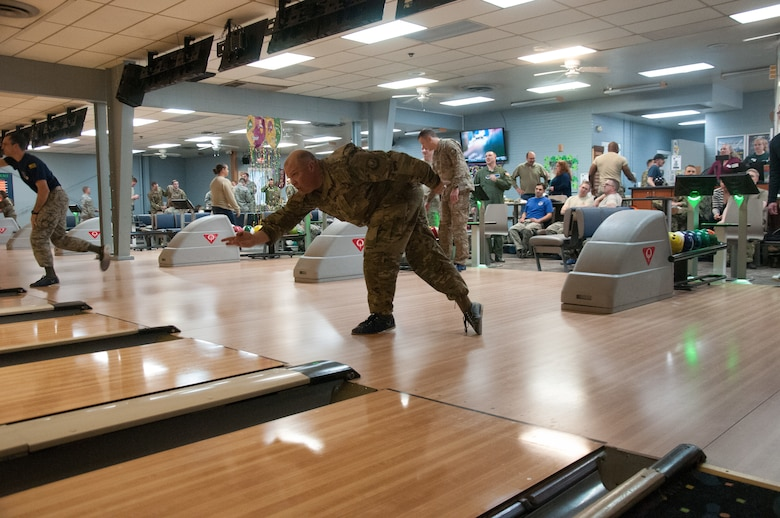 Col. Matthew Dillow, 20th Air Force vice commander, bowls at the F. E. Warren bowling alley on F. E. Warren AFB, Wyo. March 8, 2019. 20th Air Force headquarters staff organized a bowling tournament in honor of the 75th anniversary of 20th Air Force. (U.S. Air Force photo by 1st Lt Ieva Bytautaite)
