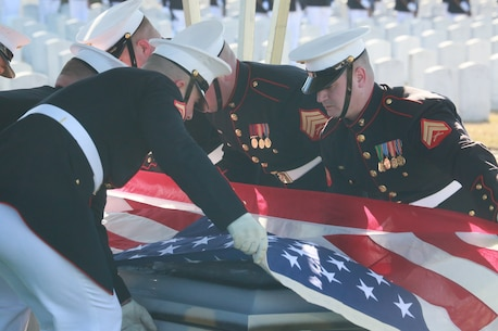 Marine Corps Body Bearers, Bravo Company, Marine Barracks Washington D.C., prepare to fold the National Flag during a full honors funeral for Lt. Gen. Leo Dulacki at Arlington National Cemetery, Arlington, Virginia, March 13, 2019.