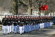 Marines with Bravo Company, Marine Barracks Washington D.C., march in formation during a full honors funeral for Dulacki at Arlington National Cemetery, Arlington, Virginia, March 13, 2019.