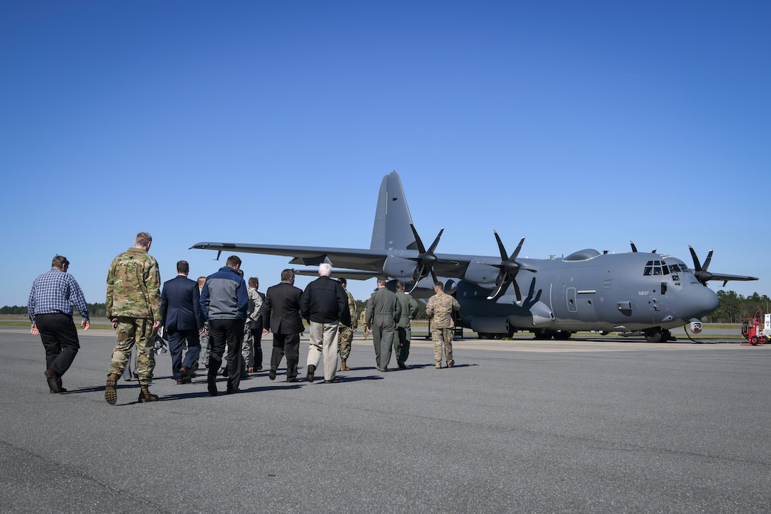 Airman and civilians walking out to aircraft