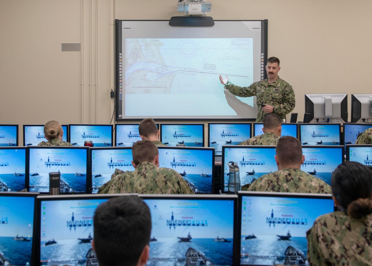 Lt. Erik Farney briefs students