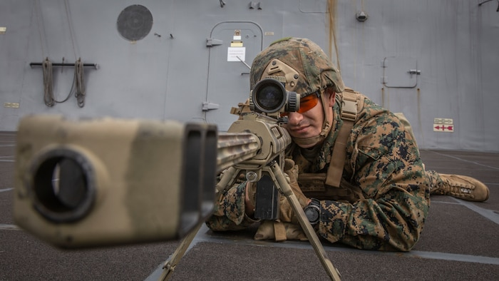 U.S. Marine Corps Sgt. Benjamin Westmoreland, a chief scout sniper with Weapons Company, Battalion Landing Team 3rd Battalion, 5th Marine Regiment, 11th Marine Expeditionary Unit, sights in behind a .50-caliber Special Applications Scoped Rifle aboard the San Antonio-class amphibious transport dock ship USS John P. Murtha. The Marines and Sailors of the 11th MEU are conducting routine operations as part of the Boxer Amphibious Ready Group in the eastern Pacific Ocean.