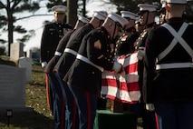 Body Bearers, Bravo Company, Marine Barracks Washington D.C., fold the National Flag during a full honors funeral for Lt. Gen. John I. Hudson at Arlington National Cemetery, Arlington, Virginia, Feb. 26, 2019.