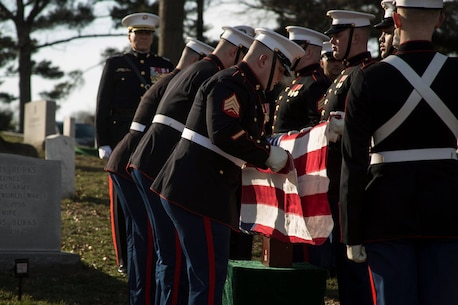Body Bearers, Bravo Company, Marine Barracks Washington D.C., fold the National Flag during a full honors funeral for Lt. Gen. John I. Hudson at Arlington National Cemetery, Arlington, Virginia, Feb. 26, 2019.