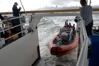 Crewmembers aboard a 26-foot Over the Horizon IV Cutter Boat enter the stern ramp of the Coast Guard Cutter Robert Ward after demonstrating the maneuverability of the OTH-IV in San Francisco Bay, Feb. 27, 2019.