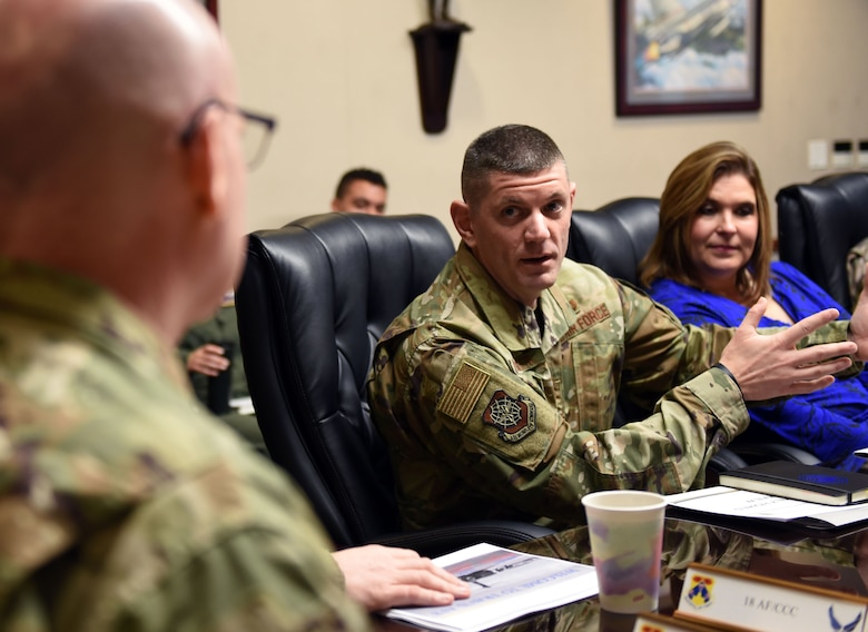 U.S. Air Force Chief Master Sgt. Derek Crowder, 60th Air Mobility Wing command chief, briefs U.S. Air Force Maj. Gen. Sam Barrett, 18th Air Force commander, during a visit to Travis Air Force Base, California, March 5, 2019. Barrett, along with his wife, Kelly and U.S. Air Force Chief Master Sgt. Chris Simpson, 18th Air Force command chief, toured the base March 4 to 8 as part of a scheduled visit. (U.S. Air Force photo by Airman 1st Class Christian Conrad)