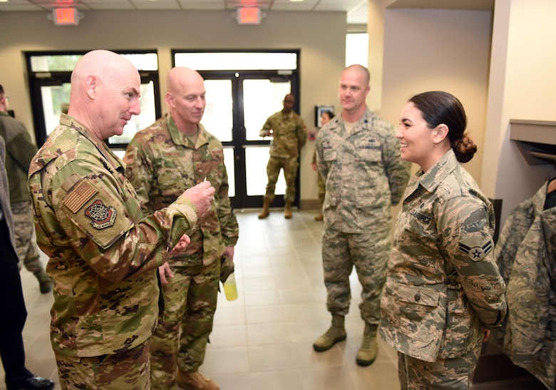 U.S. Air Force Maj. Gen. Sam Barrett, 18th Air Force commander, presents a coin to star performer U.S. Air Force Airman 1st Class Delaina McLeran, 60th Force Support Squadron food service specialist, during a visit to Travis Air Force Base, California, March 6, 2019, at the base's dining facility. Barrett, along with his wife, Kelly and U.S. Air Force Chief Master Sgt. Chris Simpson, 18th Air Force command chief, toured the base March 4 to 8 as part of a scheduled visit. (U.S. Air Force photo by Airman 1st Class Christian Conrad)