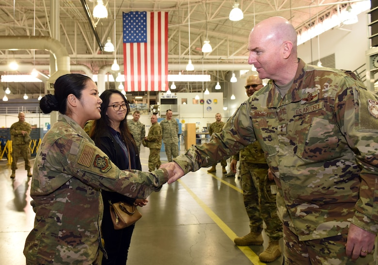 U.S. Air Force Maj. Gen. Sam Barrett, 18th Air Force commander, presents a coin to star performer U.S. Air Force Airman 1st Class Kristyn Fernando, 60th Maintenance Squadron fuel system apprentice, during a visit to Travis Air Force Base, California, March 5, 2019. Barrett, along with his wife, Kelly and U.S. Air Force Chief Master Sgt. Chris Simpson, 18th Air Force command chief, toured the base March 4 to 8 as part of a scheduled visit. (U.S. Air Force photo by Airman 1st Class Christian Conrad)
