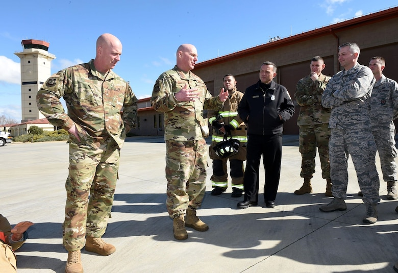 U.S. Air Force Chief Master Sgt. Chris Simpson, 18th Air Force command chief, and U.S. Air Force Maj. Gen. Sam Barrett, 18th AF commander, meet with members of Travis Air Force Base, California's fire emergency services at the Travis fire department March 6, 2019. Simpson and Barrett toured the base March 4 to 8 as part of a scheduled visit. (U.S. Air Force photo by Airman 1st Class Christian Conrad)