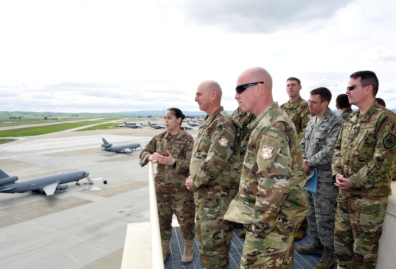 U.S. Air Force Maj. Gen. Sam Barrett, 18th Air Force commander, and U.S. Air Force Chief Master Sgt. Chris Simpson, 18th Air Force command chief, tour the air traffic control tower at Travis Air Force Base, California, March 7, 2019. Barrett and Simpson toured the base March 4 to 8 as part of a scheduled visit. (U.S. Air Force photo by Airman 1st Class Christian Conrad)