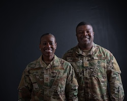 Chief Master Sergeant Rochelle Hemingway, 56th Aerospace Medicine Squadron superintendent, stands with her husband, Chief Master Sergeant Dominic Hemingway, 56th Maintenance Group superintendent.  They have weathered the ups and downs that come with any demanding job and cheered each other on through the ranks as they climbed to the top one percent of the enlisted force. (U.S. Air Force photo by A1C Aspen Reid)
