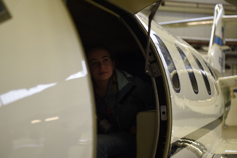 Chloe Perrow, Ramstein High school student sits in a static display of a C-21 Learjet at a Young Women in Aviation Day event on Ramstein Air Base, Germany, March, 9, 2019. A group of approximately 100 students from various schools around the Kaiserslautern Military Community came to Ramstein to learn about the ranging careers of women working in the aviation field.