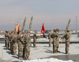 Soldiers of the 1st Infantry Division Sustainment Brigade stand during in their transfer of authority ceremony, at Bagram Air Field, Afghanistan, Feb 26, 2019.