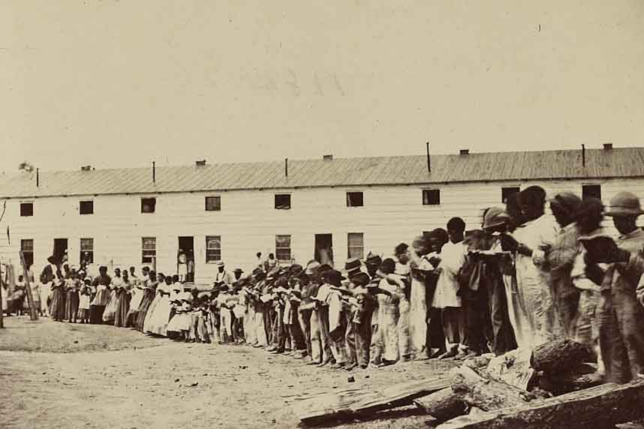 Freed slaves stand in line.
