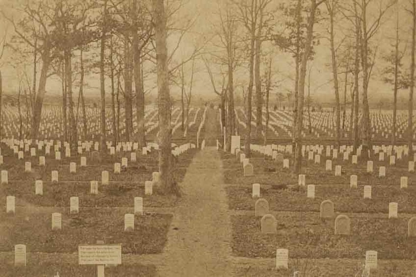 Historic image of rows of tombstones at Arlington National Cemetery.