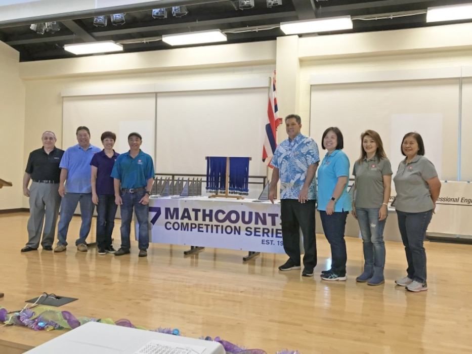 "HONOLULU, Hawaii (March 9, 2019) -- Honolulu District employee volunteers stand ready to distribute awards for the 2019 State MATHCOUNTS competition held at the Kamehameha Schools.  Honolulu District has actively supported the MATHCOUNTS program since 1997 and provided volunteer ""engineer"" workforce for the events. Shown here (left to right) are MATHCOUNTS' lead proctor and master of ceremonies (and former Honolulu District Chief, Construction branch) Lou Muzzarini, Honolulu District's Kevin Araki, Pacific Ocean Division's Alina Cayetano, Honolulu District's Steve Cayetano, Billy Borengasser, Wendy Mow, Jin Onuma, and Robyn Au."