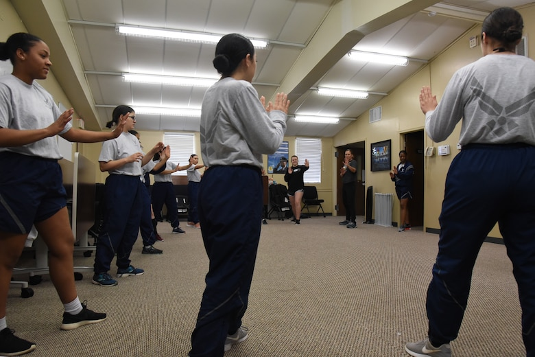 Goodfellow women practice warning contact, a defensive position, at a women's self-defense class in the Goodfellow Resiliency Center, on Goodfellow Air Force Base, Texas, March 8, 2019.  This course was free and participants were given a lifetime practice policy, allowing them to attend other classes throughout the country for free. (U.S. Air Force photo by Airman 1st Class Abbey Rieves/ Released)