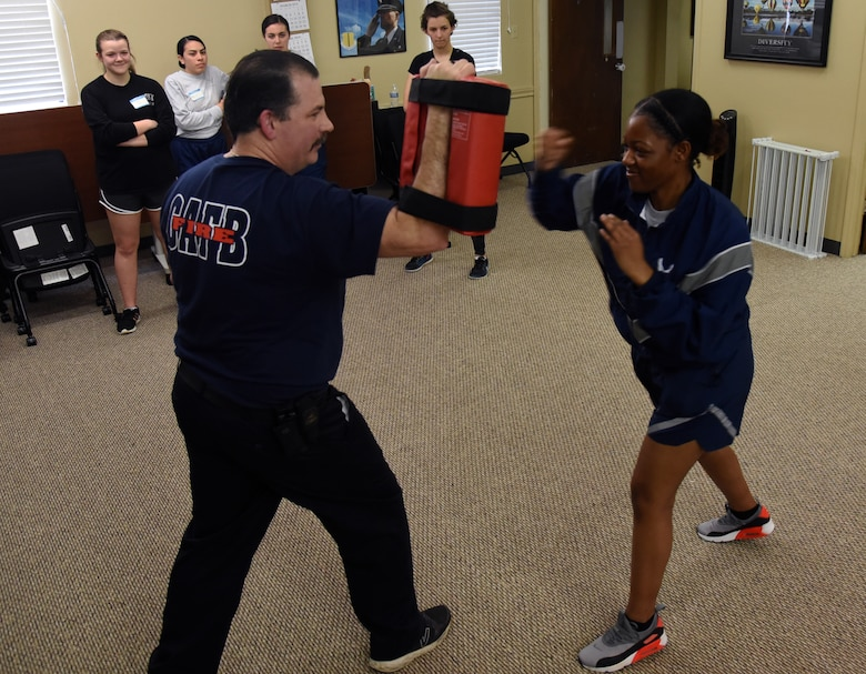 U.S. Air Force Airman 1st Class Mykaela Williams, 315th Training Squadron student, uses the hammer fist striking technique on an aggressor, during a women's self-defense class in the Goodfellow Resiliency Center, on Goodfellow Air Force Base, Texas, March 8, 2019. The fast strike of the hammer fist allowed Williams to quickly return to the defensive position. (U.S. Air Force photo by Airman 1st Class Abbey Rieves/ Released)