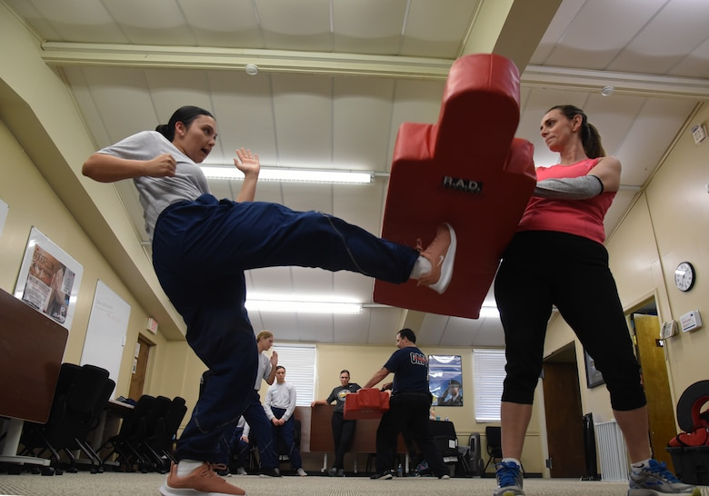 U.S. Air Force Airman 1st Class Mariscea Valdivia, 315th Training Squadron student, learns to kick from her knee during a women's self-defense class in the Goodfellow Resiliency Center, at Goodfellow Air Force Base, Texas, March 8, 2019. The kick was designed as self-defense to hit the pelvic or groin area of an aggressor. (U.S. Air Force photo by Airman 1st Class Abbey Rieves/ Released)