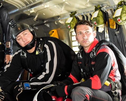 Fort Benning Silver Wings and Red Devil Soldiers on a plane preparing for a jump at 13,000 altitude. These teams use joint training opportunities to learn and grow as Soldiers and parachute team.
