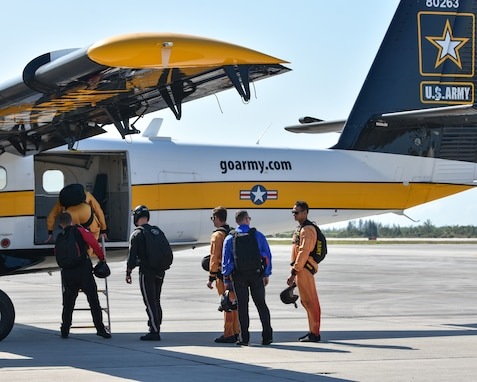 Soldiers from multiple teams prepare to board the Golden Knights plane for another practice jump.