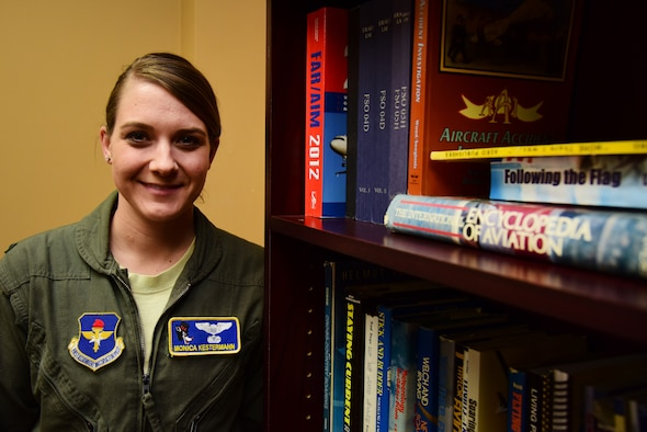 "One project 1st Lt. Monica Kestermann, 86th Flying Training Squadron T-1A Jayhawk instructor pilot, is working on is finalizing a library in the break room with books of aviation and leadership for pilots and students during their down time at Laughlin Air Force Base, Texas. She was recognized by wing leadership as this week's ""XLer"" for not only her dedication to her students but to her job and her squadron as well. (U.S. Air Force photo by Airman 1st Class Anne McCready)"
