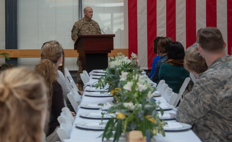 U.S. Air Force Col. David Hammerschmidt, 60th Aircraft Maintenance Group commander, delivers the opening remarks during the Key Spouse Recognition event at the 60th MXG atrium, Feb. 8, 2019 at Travis Air Force Base, California. The Key Spouse Program is an Air Force-wide volunteer program that builds and fosters support for military families through outreach education events and providing families a link to leadership.(U.S. Air Force photo by Heide Couch)