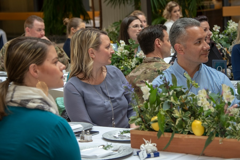 Audience members listen to remarks given at the Key Spouse Recognition event at the 60th Maintenance Group atrium, Feb. 8, 2019 at Travis Air Force Base, California. The Key Spouse Program is an Air Force-wide volunteer program that builds and fosters support for military families through outreach education events and providing families a link to leadership.(U.S. Air Force photo by Heide Couch)